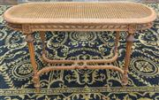 Sale 8470H - Lot 142 - A Louis XVI style carved beech table with caned panel with carved fluted legs joined by stretchers, H 53 x W 37 x L 96cm