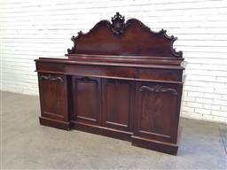 Sale 9142 - Lot 1079 - William IV Mahogany Breakfront Sideboard, with carved shaped back, above three frieze drawers & four carved panel doors, raised on p...
