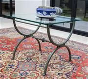 Sale 8782A - Lot 133 - A glass top coffee table with Verdigris metal x frame base height 54 x 65 x 65cm