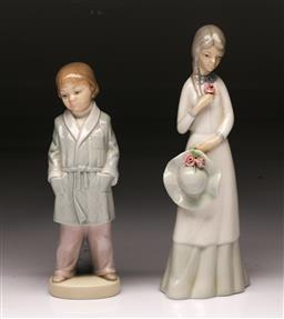 Sale 9098 - Lot 317 - Lladro figure of a child (h:21cm) together with a Spanish figure of a lady, marked to base (h:24cm)