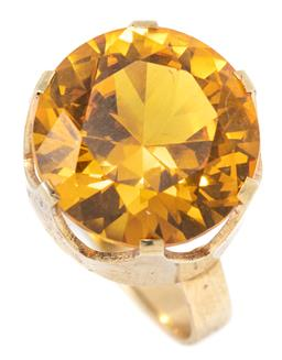 Sale 9168J - Lot 345 - A VINTAGE 14CT GOLD STONE SET COCKTAIL RING; crown claw set with a round cut synthetic yellow sapphire of approx. 15.50ct, size S1/2...
