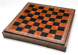 Sale 9246 - Lot 5 - A large leather topped chess set with stone pieces - some losses to box and pieces (48.5cm x 48.5cm)