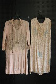 Sale 7942A - Lot 605 - Peach beaded 1920s dress with blue detail together with another peach long sleeved dress