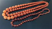 Sale 8562A - Lot 175 - A group of three toffee amber graduated bead necklaces, longest drop 38 or total L 76cm