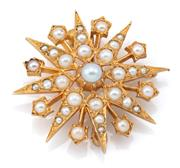 Sale 9074 - Lot 369 - A VINTAGE 9CT GOLD STARBURST PEARL BROOCH; center and radiating arms set with seed pearls, width 30mm, wt. 5.19g, hallmarked London,...