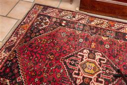 Sale 9120H - Lot 257 - A Qashqai tribal wool carpet with geometric patterns on a red ground, 160cm x 122cm