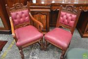 Sale 8267 - Lot 1009 - Set of Ten Edwardian Style Carved Fruitwood Chairs, incl. two armchairs, upholstered in red buttoned leather & on turned legs