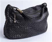 Sale 9010H - Lot 59 - An Italian made woven leather large shoulder bag in black, lined with leather ( strap attachment needs repair)