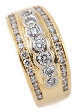 Sale 9124 - Lot 512 - AN 18CT GOLD DIAMOND RING; featuring a central row of 7 graduated round brilliant cut diamonds totalling approx. 0.35ct to adjacent...