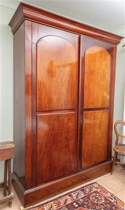 Sale 9120H - Lot 258 - A large timber two door wardrobe revealing a shelved interior on one side and a hanging rack on the other, Height 211cm x Width 166c...