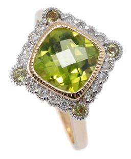 Sale 9194 - Lot 559 - A 9CT GOLD PERIDOT AND DIAMOND RING; centring a cushion cut chequerboard peridot surrounded by 16 round brilliant cut diamonds and 4...
