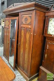 Sale 8500 - Lot 1019 - Late Victorian Walnut and Figured Panel Wardrobe, Three doors with Central Mirror enclosing Slides and Drawers