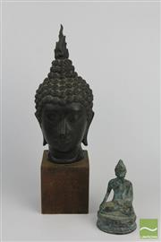 Sale 8508 - Lot 35 - Buddha Head on Stand And A small Seated Example