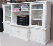 Sale 8593A - Lot 53 - An ivory laminate and glass display cabinet with two glass doors and four cupboards, H 129 x W 206 x D 64cm