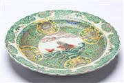 Sale 8670 - Lot 221 - Large Green Ground Charger with Fish and Flower Motif, Marked to Base (Dia 43cm)