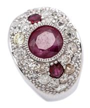 Sale 9066A - Lot 37 - AN 18CT WHITE GOLD RUBY AND DIAMOND RING; dome top deco style millegrain set with an approx. 2ct ruby to a surround of 20 pave set r...