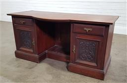 Sale 9196 - Lot 1034 - Late Victorian Walnut Desk, with breakfront top, and central alcove with foot rest, flanked by drawers & carved panel doors (h:71 x...