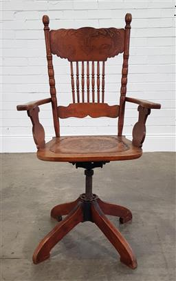 Sale 9215 - Lot 1049 - Early 20th Century American Office Desk Armchair, with pressed seat & back, raised on an adjustable base (h:115 w:63 d:44cm)