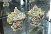 Sale 7977 - Lot 32 - Pair of English Floral Encrusted Lidded Potpourri Containers ( some losses and restoration)