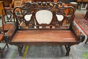 Sale 8255 - Lot 1010 - Chinese Carved Rosewood Settee, the pierced back with marble panels, surmounted by lions holding a globe like device & rolled arms
