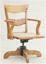 Sale 8319 - Lot 329 - Oak swivel desk chair with repair