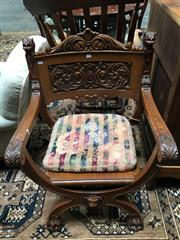 Sale 8882 - Lot 1042 - Oak Savonarola Armchair, with floral carved back panel, timber seat with loose cushion, on X frame legs