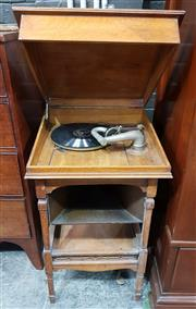 Sale 8993 - Lot 1057 - 1920s Oak Gramophone Table, with hinged top, the speaker fixed underneath, on square legs joined by a lower shelf (H:81 x W:46 x D:4...