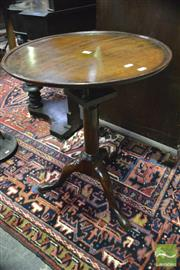 Sale 8359 - Lot 1043 - Possibly Georgian Mahogany Tilt Top Wine Table, the turned pedestal with birdcage & three outswept feet