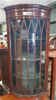 Sale 8993 - Lot 1002 - Late 19th/ Early 20th Century Mahogany Hanging Corner Cabinet, in the Georgian manner, with bowed astragal door (H:99 x W:34 x D:34c...