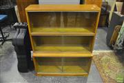Sale 8361 - Lot 1014 - 1960s oak stacking bookcase w/sliding glass doors