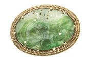 Sale 8442J - Lot 385 - A 14CT GOLD NEPHRITE PENDANT; 30 x 20mm carved nephrite to triple rope border, wt. 9.7g.