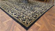 Sale 8470H - Lot 145 - A contemporary black and gold woollen carpet with repeating pattern, 302 x 243cm