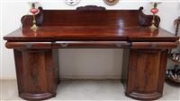 Sale 8963H - Lot 66 - A late regency mahogany breakfront sideboard with a scrolled back and rosewood cross banded top with a central and two faux drawers...