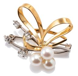 Sale 9168J - Lot 392 - AN 18CT TWO TONE GOLD DIAMOND AND PEARL BROOCH; stylised bow in yellow and white gold set with 3 cultured pearls (6.8-7.17mm) and 4...