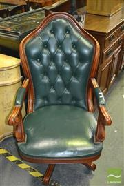 Sale 8386 - Lot 1030 - Button Back Leather Swivel Armchair