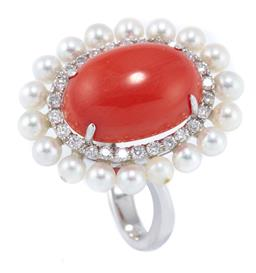 Sale 8946 - Lot 362 - AN 18CT WHITE GOLD CORAL DIAMOND AND PEARL COCKTAIL RING; featuring a 5.8ct oval cabochon coral (13.9 x 9.8mm) four claw set above a...