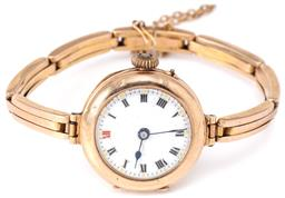 Sale 9140 - Lot 400 - A VINTAGE 9CT ROSE GOLD LADIES WRISTWATCH; round dial, Roman numerals, stem wind push pin at 4 oclock, 9ct stretch band, case diam....