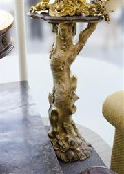 Sale 8205 - Lot 77 - A carved gilt and gessoed natural form tree trunk jadiniere plinth with shaped marble top, H 115 x W 60cm