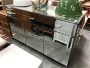 Sale 8876 - Lot 1051 - A Custom Design Mirrored Three Drawer and Door velvet lined Sideboard (Slight Chip to Top Corner, H 90cm L 151cm D 61cm) ex Peter Mo...