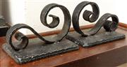 Sale 8976H - Lot 95 - A pair of wrought iron scrolled bookends 12x17cm
