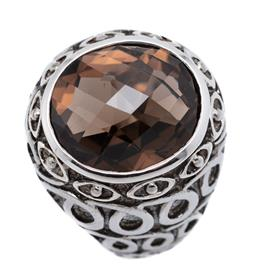 Sale 9209J - Lot 326 - A SILVER SMOKY QUARTZ RING; dome top featuring a 16 x 14mm oval chequerboard cut smoky quartz to swirling design tapered shoulders,...