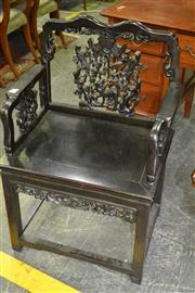 Sale 8050B - Lot 20 - A Chinese Carved Rosewood Armchair with Animals & Calligraphy Banner