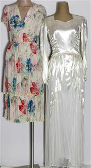 Sale 8134B - Lot 328 - TWO VINTAGE DRESSES; 1940s ivory satin wedding dress with train and 1930s floral silk crepe dress with alterations, both small.