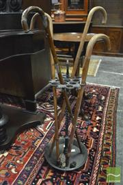 Sale 8359 - Lot 1042 - Cast Iron Stick Stand with bamboo canes, manufacturers mark to base
