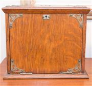 Sale 8308A - Lot 114 - A well fitted oak desk compendium with brass hardware, H 22 x W 28 x D 18cm