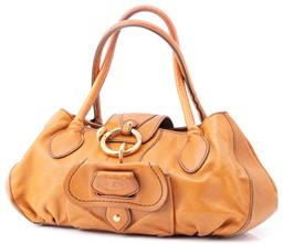 Sale 9149 - Lot 562 - A TODS LEATHER PEGGY STACHEL; in caramel leather with a front flap pocket, two rolled handles, two sections and zip up middle pocket...