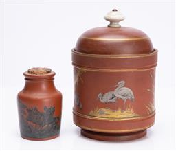 Sale 9185E - Lot 69 - A brown ceramic lidded urn decorated with cranes and cherry blossoms, Height 19.5cm together with another with cork top and hunting...