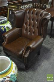 Sale 8345 - Lot 1052 - Brown Buttoned Leather Wingback Armchair