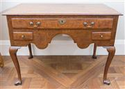 Sale 8470H - Lot 149 - A George III oak low boy fitted with a long and two short cross banded drawers above a shaped apron and cabriole legs, H 75 x W 102...