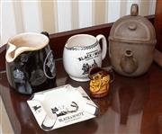 Sale 9058H - Lot 79 - A group of Black and White whisky ceramic bar wares including jugs and an ashtray, together with a McCallum miniature jug and a teapot.